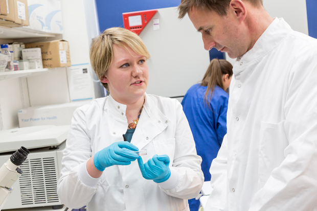 Selina explains her work to the Health Secretary Jeremy Hunt when he visited the UCL labs in 2013.