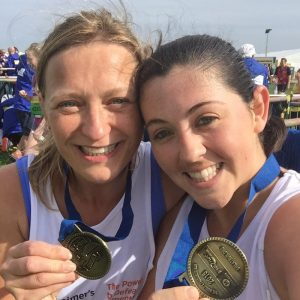 AXA runners with medals from the Great North Run